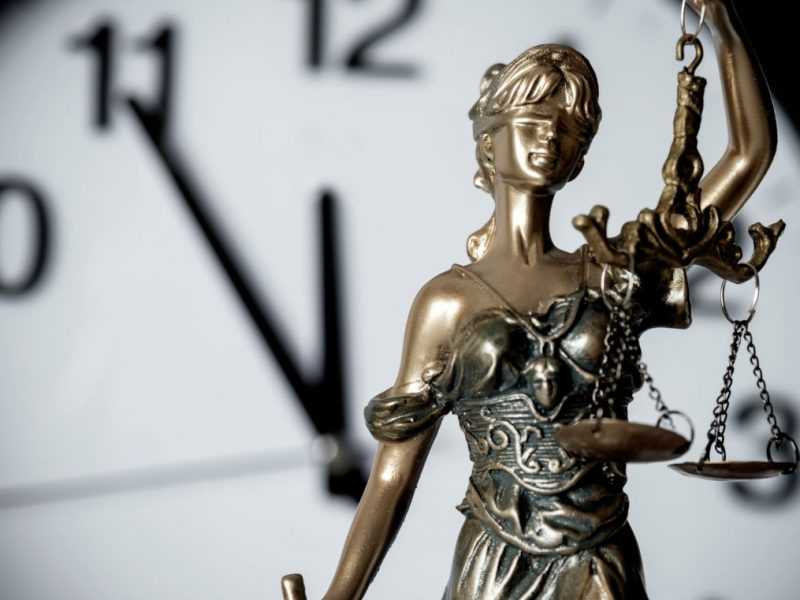 Clock and lady justice.