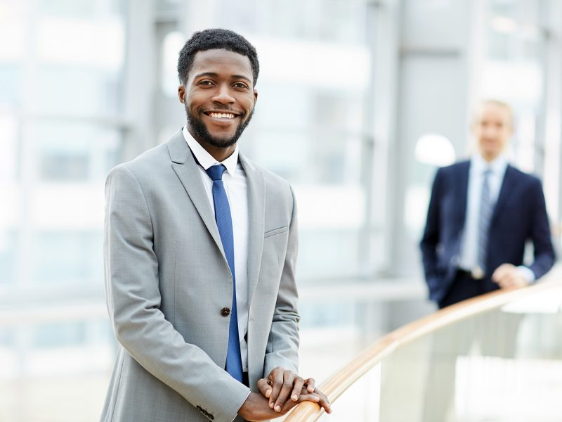 smiling-black-businessman-LUTNGCF.jpg